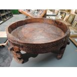 A traditional hand carved and wrought iron Indian Chakki table having good signs of age