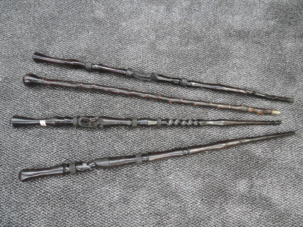 A selection of ethnic tribal walking sticks all hand worked with African designs