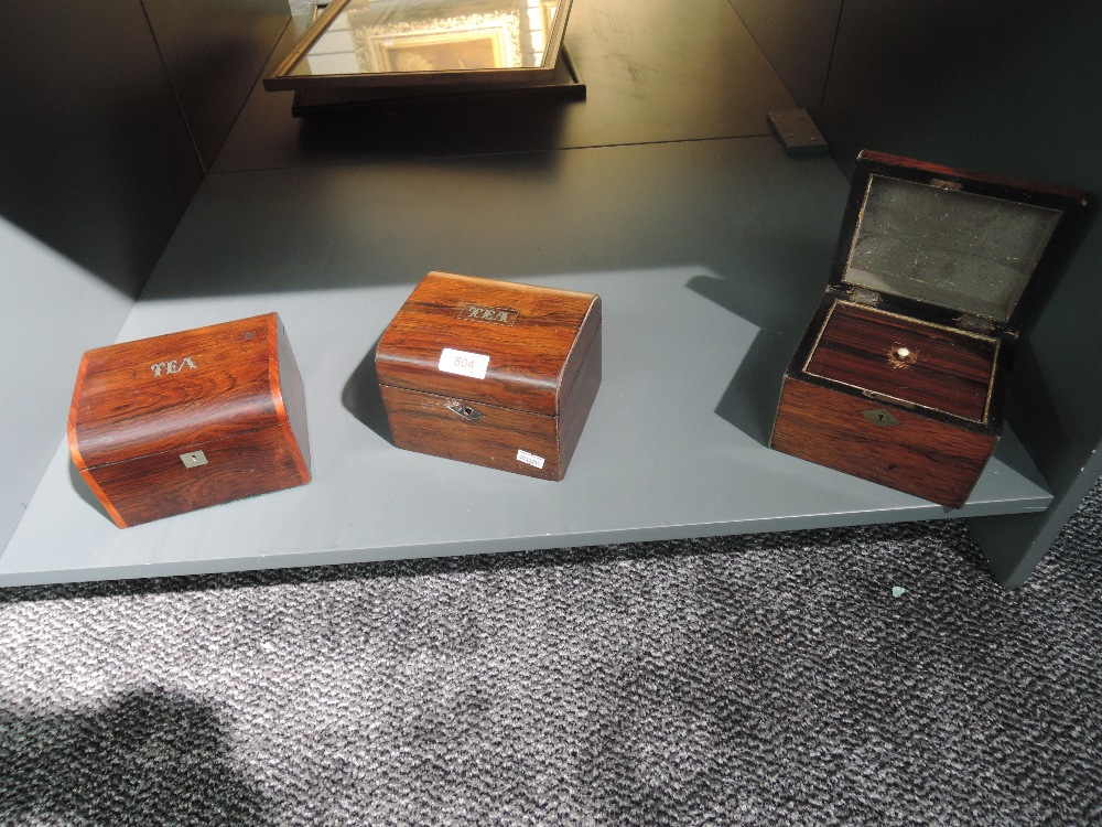 A selection of early 20th century tea caddies including rosewood cases and inlayed labels