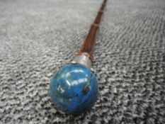 A bamboo walking cane with HM knopp ( marks worn ) holding polished ball handle Lapis Lazuli