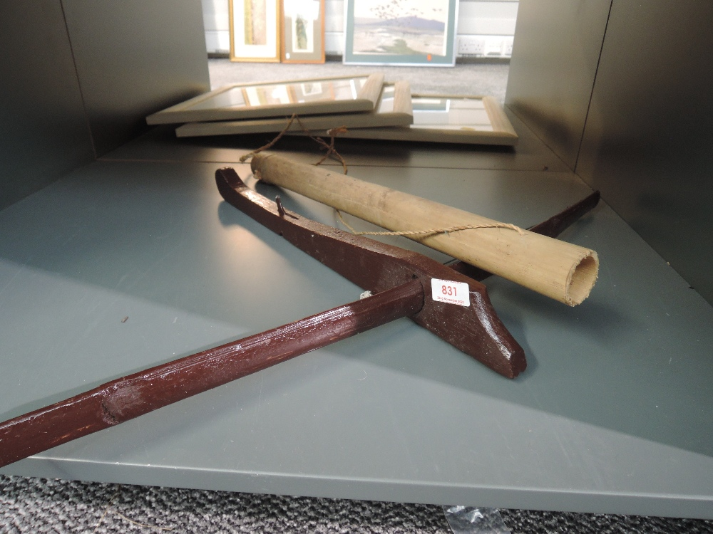 A small naive native crossbow and arrow in quiver
