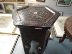 A hand carved Islamic fold away table