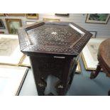 A hand carved Islamic fold away table