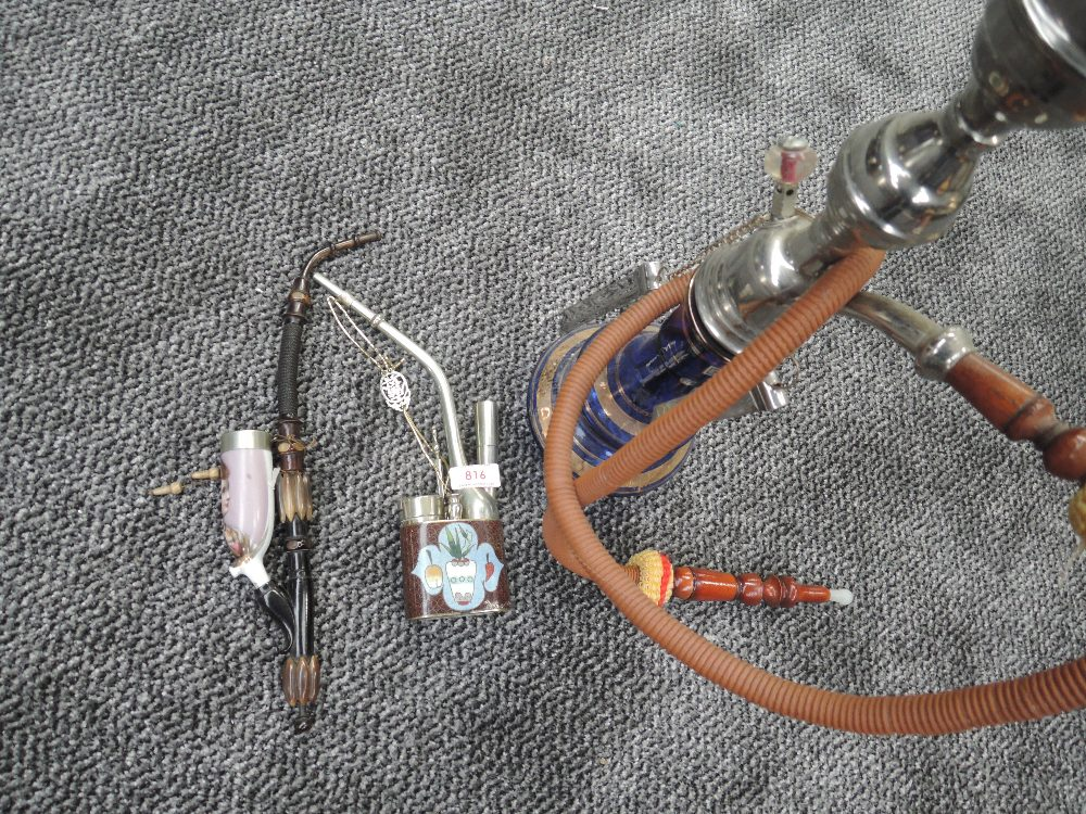 Two opium pipes one European design and similar Chinese style and Turkish hookah