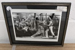 Two framed photos taken during the filming of the' It's a kind of magic' video.