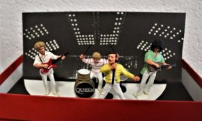 A complete set of Queen miniature metal figures boxed and in excellent condition.