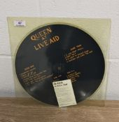 Queen at live aid and Larry Lurex demo picture disc.