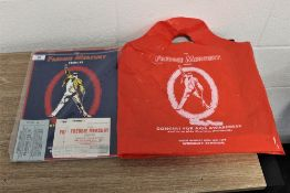 A Freddie Mercury tour programme,ticket and carrier bag.