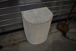A vintage Lloyd loom demi lune linen basket