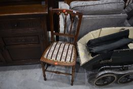 A Victorian mahogany bedroom chair with woolwork seat
