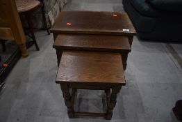 A mid to late 20th Century oak nest of tables