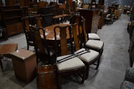 A modern Oriental extending dining table and eight (six plus two) chairs, matches bookcase lot 43