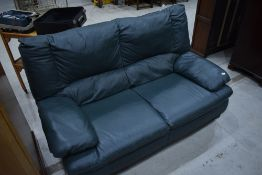 A modern green leather settee, width approx. 158cm