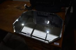 A vintage frameless canted wall mirror, width approx. 46cm