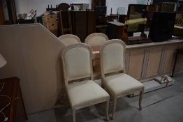 A modern octagonal table chairs and sideboard, gloss finish limed oak and peach effect, sideboard