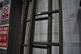 A set of aluminium extending ladders