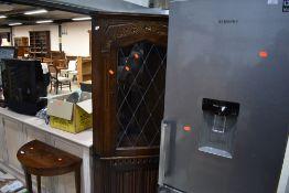 A vintage oak corner display having cupboard under, with linen fold doors, height approx. 176cm