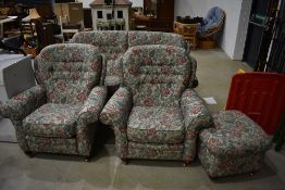 A traditional three piece suite and footstool, very clean, looks nice quality