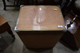 A vintage woven fibre linen basket