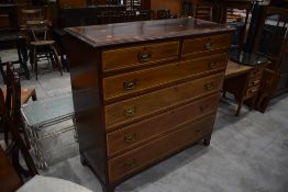 A late Victorian mahogany and satinwood inlaid chest of two over four drawers, stamped for James