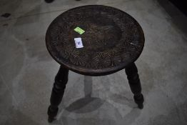 A 19th Century stained frame carved milking type stool