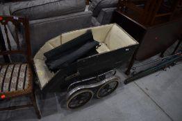 A vintage pram/pushchair