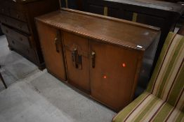 An early to mid 20th Century sideboard in the Art Deco style, approx. Dimensions W138cm D48cm