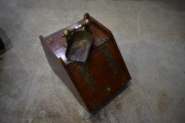 A Victorian mahogany and brass bound coal purdonium