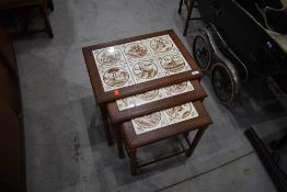 A Danish teak and tile top G plan style nest