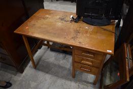 A vintage golden oak desk, nice proportions, width approx, with three drawers and blotter slide ,