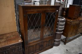 A mid to late 20th Century oak display cabinet, possibly Old Charm, width approx. 97cm, height