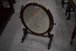 An early 20th Century mahogany toilet mirror (missing top finial)