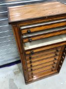 A 19th Century satinwood and mahogany wellington chest of 12 drawers, top loose (been removed for