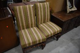 A pair of Period turned frame dining chairs having later upholstery