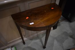 An early 20th Century mahogany half moon table, of small proportions, on spade feet, width approx.