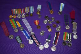 A Collection of mixed vintage Miniature and Full Size Medals some with ribbons
