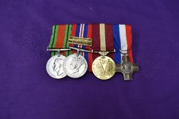 A WW2 group of 4 medals, Defence Medal, War Medal with Gloucestershire Regiment and Suffolk Regiment