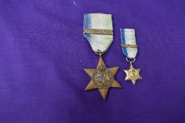 A Unnamed WW2 Atlantic Star with Air Crew Europe Class along with a Miniature Medal