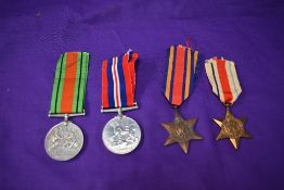A group of four WW2 Medals, Burma Star, Africa Star, Defence Medal and War Medal all unnamed