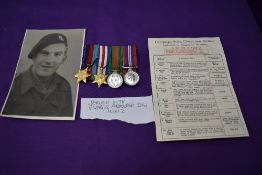 A group of four WW2 miniature medals, 39-45 Star, France Germany Star, War Medal and Defence Medal