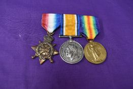 A WW1 group of three medals, 1914-15 Star, unnamed, War and Victory Medals both named 104368 SPR.