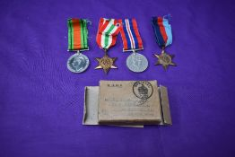 A group of four WW2 Medals, Defence Medal, War Medal, 1939/45 Star and Italy Star, in original box