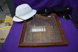 A Military white Pith Helmet, size 7, a black Military Beret and visor cap along with a copy of a