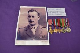 A group of five miniature medals to LT Col Woodward, OBE, 39-45 Star, Burmah Star, Defence Medal,