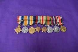 A group of WW1 and WW2 miniature medals, 1914-15 Star with clasp 5th Aug-22 Nov 1914, War Medal,