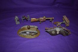 A collection of WW1 Trench Art including German Tri-Plane, Loius Machine Gun, British Tank, Shrapnel