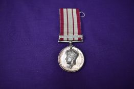 A Naval General Service Medal, unnamed, with Minesweeping 1945-51 bar