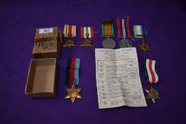 A group of seven WW2 Medals, War Medal, Defence Medal, Atlantic Star with France and Germany
