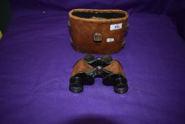 A pair of Bausch & Lomb Optical Co USA US Army Signal Corps Binoculars, serial no EE26726, with