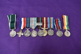 A group of six miniature medals, General Service Cross, National Service Medal, British Army of